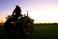 Tractor farmer sunset